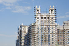 Part of the high-rise building in scaffolding. Royalty Free Stock Photos