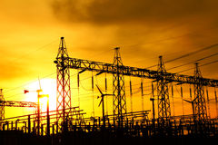 Part of high voltage substation at sunset. Stock Image