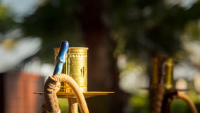 Part of hookah, traditional arabic waterpipe, in the arabic rest Royalty Free Stock Photo