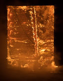 Part of a House on Fire. Window view to Fire Inside Wooden Old H. Photo of Part of a House on Fire. Window view to Fire Inside Wooden Old House Royalty Free Stock Image