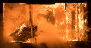 Part of a House on Fire. Window view to Fire Inside Wooden Old H. Photo of Part of a House on Fire. Window view to Fire Inside Wooden Old House Royalty Free Stock Photography