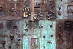 Part of immense bronze wall designed for visually impaired, FDR memorial, Washington, DC, 2017. One section of massive bronze wall designed with the visually Stock Photo
