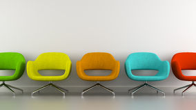 Part of interior with multicolored modern armchairs Royalty Free Stock Photography