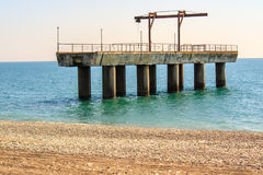 Part of the jetty on sea. Part of the pier on the black sea in Abkhazia, near the town Stock Images