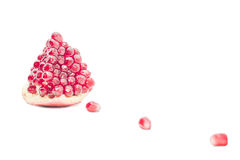 Part of juicy pomegranate. On a white background Stock Image