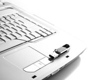 Part of keyboard with flash device on it. Stock Photo