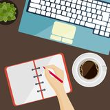 Part of keyboard, notepad and cup of coffee in flat design Stock Images