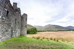 Part of Kilchurn Castle in scottish highlands. Loch Awe. Part of Kilchurn Castle stone wall in the highlands landscape near Loch Awe, Scotland, UK. Horizontal Stock Photo