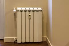 Part of kitchen and heating radiator Stock Image