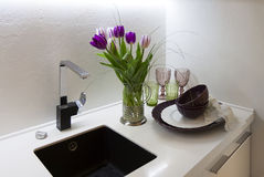 Part of the kitchen interior with tulips Stock Photos