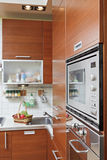 Part of Kitchen interior with wooden furniture. And build in microwave oven Royalty Free Stock Photo