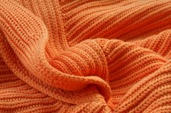 Part of knitted wool. Part of knitted orange wool closeup, pullover Stock Photos
