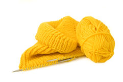 Part of knitted wool. Yellow knitting on white background stock photo
