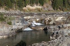 Wild Kootenai River branch rock in Northwestern Montana. Part of the Kootenai Falls in Northwestern Montana. the River of the Kootenai flows through rugged rocks stock image
