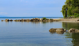 Part of lake Leman coast with rocks in water Stock Images