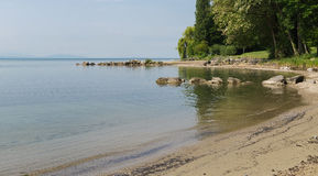 Part of lake Leman coast with rocks in water Stock Photos