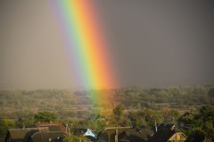 Part of a large rainbow over the private sector, close-up, a rainbow over a residential area of the city stock photos