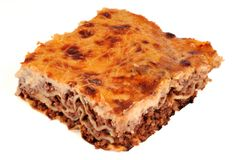 Part of lasagna with beef on white background royalty free stock photography