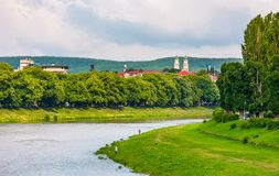 Part of the Linden alley on the embankment. Of river Uzh. beautiful sunny summer day in Uzhgorod town. travel destination concept Royalty Free Stock Images
