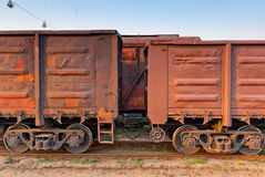 Part of a long freight train. Is on the tracks Stock Photos