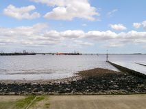 Part of long tanker off-loading jetty by seashore Royalty Free Stock Photo