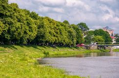 Part of a longest linden alley in Europe. Uzh river embankment of Ukrainian town Uzhgorod in summer Stock Images