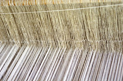 Part of loom white thread homemade Stock Image