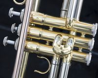 Part of loud brass orchestra instrument trumpet. Valve part of loud brass orchestra instrument trumpet Royalty Free Stock Photos