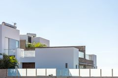 Part of a luxurious dream home in a modern design against a blue sky royalty free stock image