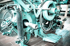 Part of machine in fabric. Mechanism, photo toned colour in blue Royalty Free Stock Images