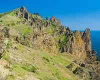 Part of majestic Karadag, volcanic mountain in Eastern Crimea. Dead City - part of majestic Karadag, volcanic mountain range in Eastern Crimea, on a Black Sea royalty free stock images