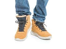 Part of male legs in winter boots. Over white background Royalty Free Stock Images