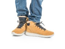 Part of male legs in winter boots. Over white background Royalty Free Stock Photography