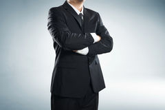 Part of man body side folded his arms in black suit Royalty Free Stock Image