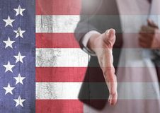 Part of a man offering his hand against american flag Stock Image