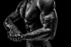 Part of a man`s body on a dark background with copyspace Royalty Free Stock Images