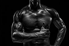 Part of a man`s body on a dark background with copyspace Stock Photos