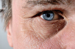 Part of a seniors face with blue eye Stock Image