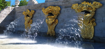 Part of the Marlinsky cascade `gold mountain` in Petrodvorets. The water flows from the heads of the three gilded sea monsters Stock Photos