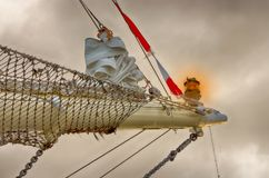 Part of the mast of a sailing ship. Ropes, lantern. stock photo