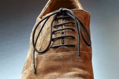 Part of mens brown shoe close-up. Royalty Free Stock Photos