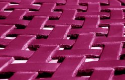 Part of metal construction pattern in pink tone. Abstract background and texture for design royalty free stock photography
