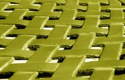 Part of metal construction pattern in yellow tone. Abstract background and texture for design royalty free stock image