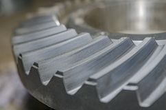 Part of metal gear. Gear manufacturing industry Industrial gear Metal Close-up Royalty Free Stock Photography