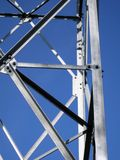 Part of metallic construction. Detail of big metallic tower construction and sky Royalty Free Stock Images