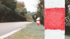 Part of milestone with blurred road as background, hope for success. Concept stock images