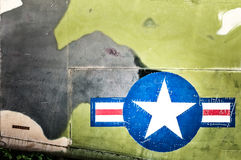 Military plane with star and stripe sign. Royalty Free Stock Images