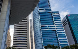Part of modern  building and blue glass skyscapers Royalty Free Stock Photography