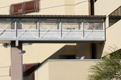 Part of a modern building with pedestrian bridge stock image