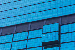 Part of modern design blue glass building exterior. Jakata Royalty Free Stock Photo